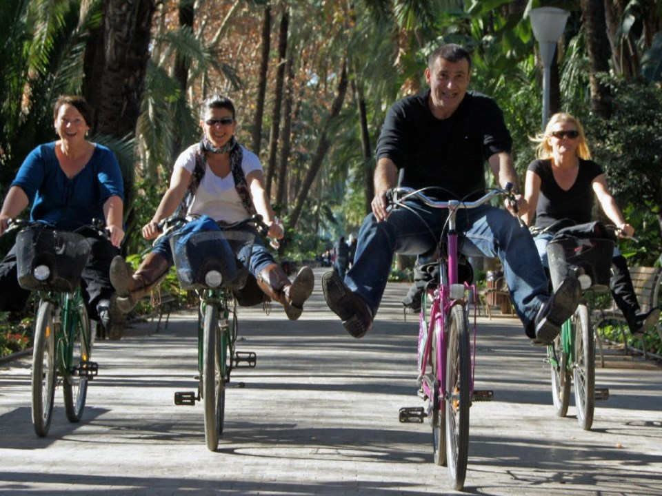 Happy People on Bikes in Malaga