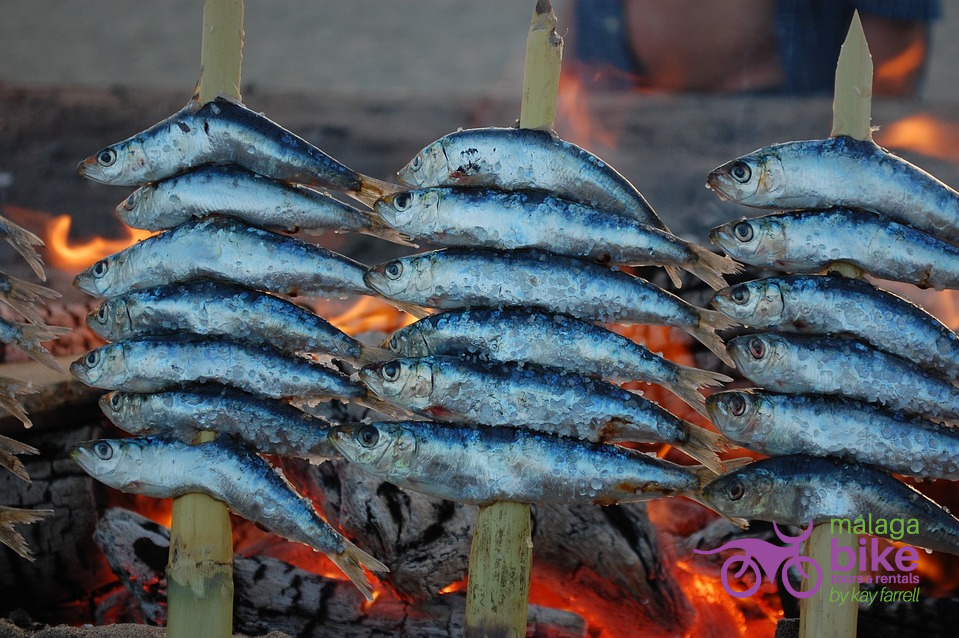 Espeto de Sardinas- fresh sardines cooked on the beach bar boat barbecues